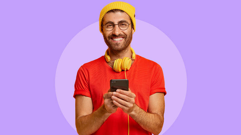 guy with glasses headphones mobile phone purple background