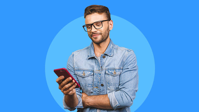 man looking at mobile phone blue background