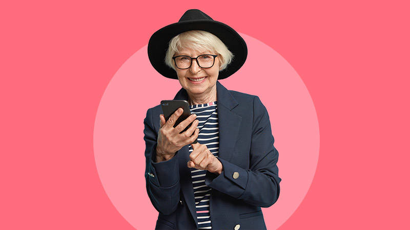 older women with mobile phone red background