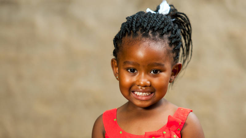 A young girl smiles for the camera